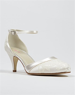 Closed toe lace and satin wedding shoe.