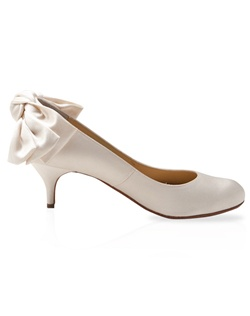 Ivory silk pump features back-bow detail. Also customizable in various colors, fabrics, and heel heights.