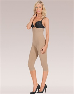 Loop and Strap system holds shaper in place while attaching to your bra. Slims tummy, back, hips, thighs and legs. Shapes and lifts bottom. Targeted compression for defined shape. Seamless and breathable microfiber that wicks moisture away from the body. Cotton lined convertible gusset for convenience and comfort. Care: Machine wash delicate with like colors, hang to dry. Do not bleach, iron or dry clean.