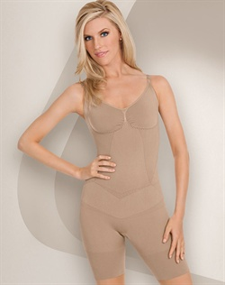 Seamless body shaper. Slims tummy, back, hips, and thighs. Shapes and lifts bottom. Thigh band lies flat without rolling. Targeted compression for defined shape. Seamless and breathable microfiber that wicks moisture away from the body. Cotton lined convertible gusset for convenience and comfort. Care: Machine wash delicate with like colors, hang to dry. Do not bleach, iron or dry clean.