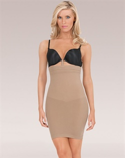 Loop and Strap system holds shaper in place while attaching to your bra. Slims tummy, back, hips, and thighs. Shapes and lifts bottom. Change in weave from hips down prevents slip from rolling up. Targeted compression for defined shape. Seamless and breathable microfiber that wicks moisture away from the body. Cotton lined convertible gusset for convenience and comfort. Care: Machine wash delicate with like colors, hang to dry. Do not bleach, iron or dry clean.