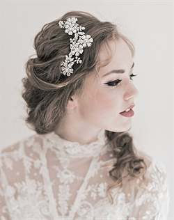 A Swarovski crystal garden is enchanting and romantic on this stunning hair comb.  It's versatile shape can be worn with down hair styles as well as up-dos. Available in silver or gold finish. Shown in silver