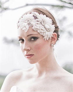 Ethereal, romantic, and feminine. Hand pressed silk flowers and leaves with Swarovski crystal accents. Available in ivory or diamond white.