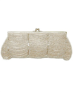 As seen in Brides and Ceremony magazines, this vintage inspired clutch is stunning! Silk clutch with hand beaded waves of beading throughout.