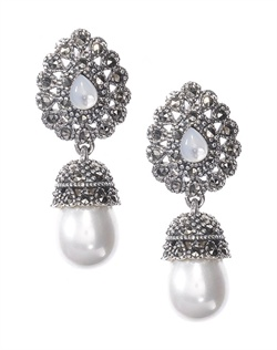 Elegant stud earrings adorned with white, man-made pearl drop, set off by opaque briolette stone and ornate oxidized silver details. Brass with rhodium plating (shown in silver marcasite finish) with post back.