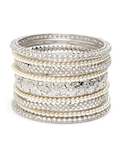 Sleek, elegant stack of nine bangles, designed with an intricate pattern of white, man-made pearls, inset crystal zirconia and round-cut crystals. Set in brass with rhodium plating (shown in silver finish).