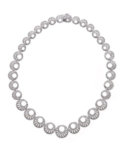 Stylish round silhouette necklace with medley of circles embellished with pavթ cubic zirconia. Brass with rhodium plating (shown in silver finish).