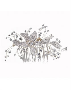 Eye-catching hair comb with whimsical interplay of silver details dotted with round-cut crystals and shimmering pavé cubic zirconia flora. Brass with rhodium plating (shown in silver finish).