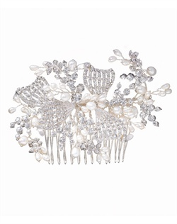 Ornate hair comb with intricate curves and stunning mix of cubic zirconia, round-cut crystals and white, man-made pearls. Brass with rhodium plating (shown in silver finish).