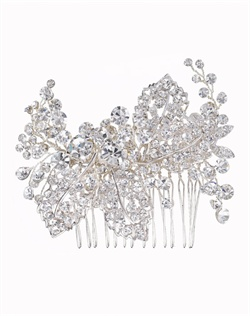 Dramatic hair comb with dazzling petite and large round-cut crystals and fine silver details. Brass with rhodium plating (shown in silver finish).