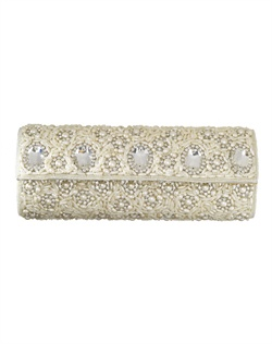 Elegantly adorned purse with lavish white, man-made pearls, intricate beading and bold stones. The pearl chain strap can be tucked into purse to transform into clutch.