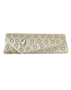Chic purse with asymmetrical styling, a single bold stone enveloped by intricate beading and lavish white, man-made pearls. The pearl chain strap can be tucked into purse to transform into clutch.