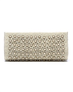 Classically styled purse dotted with white, man-made pearls framed by intricate beading and stones. The pearl chain strap can be tucked into purse to transform into clutch.