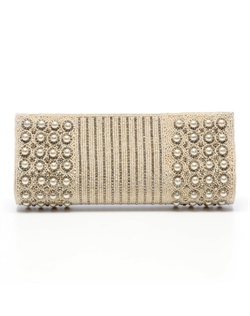 Dramatic purse with linear contours dressed with white, man-made pearls, intricate beading and stones. The pearl chain strap can be tucked into purse to transform into clutch.