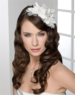 Trendy fascinator headband of double satin flowers and beaded leaves.