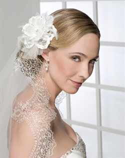 Romantic flower of lace and satin petals with horsehair loops and feathers, on a clip. Shown with a 1 layer fingertip length veil of delicate embroidery (V7108).