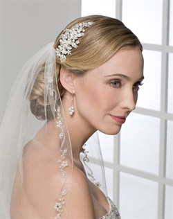 Stylish comb of rhinestone flowers, leaves, and pearls. Shown with a 1 layer fingertip length silver rolled edge veil with embroidery and pearl flowers (V7061).