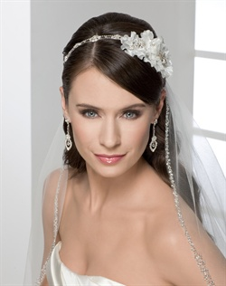 Rhinestone tie-headband with side flowers. The rhinestone portion can be detached and worn as a bracelet. Shown with a 1 layer fingertip length veil with silver beaded & rhinestone edge (V7116).