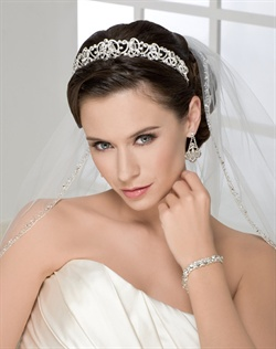Elegant contour rhinestone tiara with baguettes. Shown with a 1 layer elbow length silver edge veil with narrow beading (V7056).