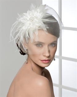 Stylish horsehair brim hat with flower, feathers, & rhinestones at center.
