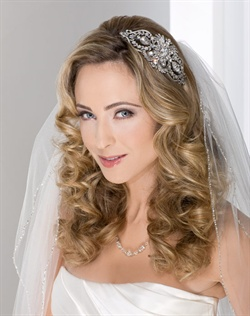 Headband with dramatic and vintage side design. Shown with a 2 layer fingertip length veil with silver beaded edge (V7055).
