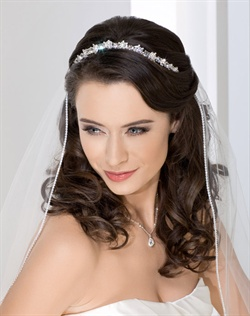 Classic narrow rhinestone contour tiara. Shown with a 1 layer elbow length veil with Swarovski crystal edge (V8334).