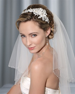 Alençon lace headband accented with rhinestones. Shown with a 2 layer shoulder veil with crystal & rhinestone edge (V7015).