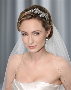 Sparkling side design of marquis rhinestone leaves attached to narrow fabric headband. Band is available in brown, tan, or ivory to blend with hair color. Shown with a 1 layer fingertip cut edge veil with crystal, rhinestone, and beaded edge (V7106)
