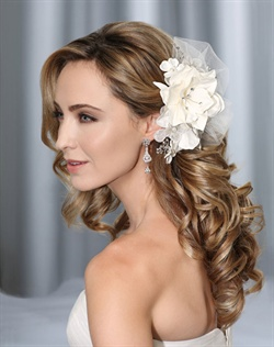 Floral clip accented with rhinestone sprays and tufts of tulle.