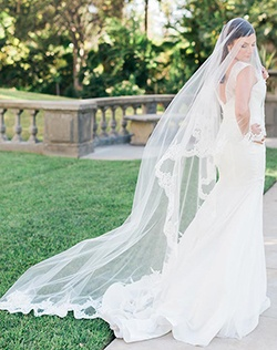 Cathedral mantilla veil with exquisite beaded Alençon lace edge.