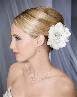 Romantic satin and organza flower centered with large stones on a clip.