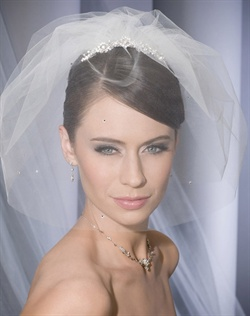 Petite rhinestone tiara comb attached to a 2 layer mini cage veil dotted with rhinestones.