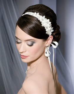 Grosgrain ribbon tie headband with organza flowers and beaded leaves.