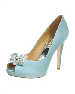 The Cleone by Badgley Mischka is a stunning work of art. The basic platform peep toe design is kept simple so it can spotlight the amazing brooch at the toe. The gorgeous light &quot;Nile Blue&quot; satin is the perfect something blue shade. The brooch features clear, crystal set and enamel flower petals creating a 3D effect with a glittering crystal center. The heel measures 4.5&quot; with a covered 1/2&quot; platform. Available in Nile Blue.