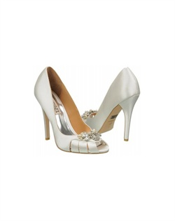 "The Badgley Mischka Monique is a stunning work of art on a heel. The classic peep toe and enclosed heel design is traditional yet modern. The front is delicately adorned with an art deco style pearl and crystal accent. The toe are is also cut for a more eye catching effect. The heel measures 4 1/4"". Available in Diamond White."