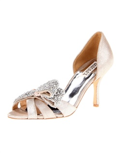 "The Vita by Badgley Mischka is a stunning sandal with amazing versatility. The Platinum metallic materials make the color great for almost any attire or event. The multi-strap front is accented with a fold over bow design that is covered in soft silver beading. The D'orsay back features a perfect 3 1/2"" heel."