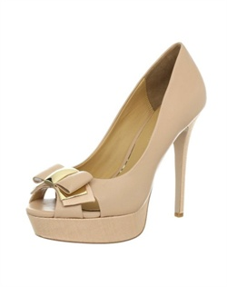 The Conary by Badgley Mischka is a must have this season. The sweet and feminine styling of this peep toe platform feature leather materials combined with gross grain ribbon accents. The Bow embellishment at the toe contains gold hardware accents.The heel is 5 1/4&quot; with a 1&quot; platform front.