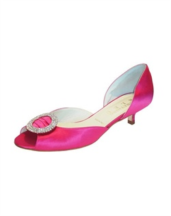 "The perfect compliment to any classic little black dress and beyond. The Trista by Something Bleu creates a major statement in the vibrant Fuchsia shade. The round rhinestone accent at the toe catches the light and glitters with every step. The small 1 3/4"" heel is great for anyone looking for comfort and style all in one."