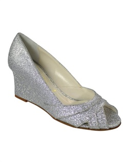 "The Something Bleu Patti Cakes is the must have evening wedge of the season. The fully coated glittered upper and wedge design catch the light and sparkle with every step. The perfect 3"" wedge heel is great for outdoor events and uneven surfaces. The cross over peep toe design creates interest in the front."