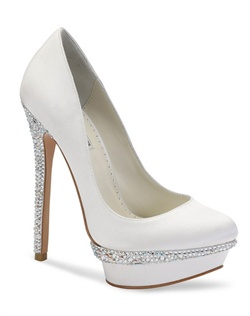 "The Benjamin Adams Cameron is a luxurious round toe silk platform with dazzling crystal heel and internal platform. The unique styling of this pump is eye catching with a glittering strip around the platform and a fully encrusted crystal heel. Heel height measures 5 1/4"" with a 1"" platform."