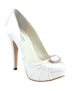 "The Benjamin Adams Portia pumps are stylish and sophisticated. The round toe platform design features overlaid pleats and a stunning Alabaster brooch at the toe. The 4 3/4"" heel is perfectly balanced with a 1"" platform front."