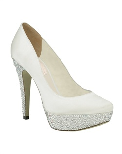 "The Bedazzle by Pink takes the ultra popular pump to a whole new level. The addition of a 1"" ""bedazzled"" rhinestone platform and 4 1/4"" matching heel create a cosmic glittering effect. The dyeable materials make this style customizable to any color for a contrasting effect. Available in dyeable white and ivory."