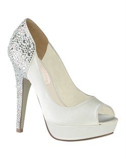 "Hot heels! The Starry by Pink has a fully encrusted rhinestone heel cap and heel that makes a major statement. The modern yet simple platform peep toe design is the perfect compliment for such a stunning back. The 4.75"" heel offers a great lift while the 1"" platform front keeps the comfort."