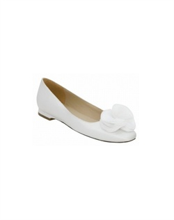 "Ivory 1/2"" flats with a decorative flower. Enjoy fashion and comfort all wedding day long with the Flower by Brianna Leigh. Decorated with a lovely ivory organza bow, the Brianna Leigh Flower bridal shoe is available in white and ivory supple silk up to size 12. 1/2"" heel, non-dyeable."