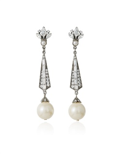 With their dramatic three inch length, these pearl and crystal bridal earrings from designer Ben Amun simply exude sophisticated glamour. A crest of marquise cut crystals tops these pretty earrings that feature a long, narrow drop leading to a luminous dangling pearl.