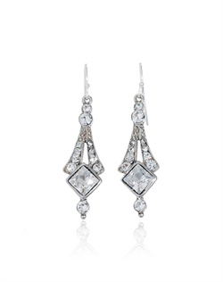 Let your wedding day jewelry evoke timeless 1920s style with these stunning crystal bridal earrings from designer Ben Amun. Square and round brilliant cut Swarovski crystals sparkle in a silver plated setting that shows off all of the trademark glamour of timeless Art Deco style jewelry.
