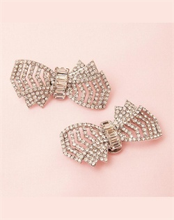 Glamorous rhinestone shoe clip bows for bridal, bridesmaid and evening shoes. Attach them on the front, side or back of shoes and add glamour and sparkle to your look.