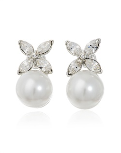 "Let your wedding jewelry make a sweet statement with these pearl and crystal bridal earrings from designer Kenneth Jay Lane. Four marquise cut Swarovski crystals sit atop a shimmering pearl forming a charming ""x"", or ""kiss"", motif. A sophisticated and sentimental choice for your wedding day."
