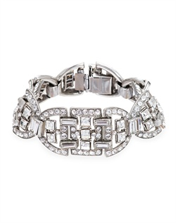 Retro glamour is the name of the game with this stunning crystal bridal bracelet. With its striking geometric design, it epitomizes the dramatic aesthetic of Art Deco jewelry. A classic and sophisticated choice for your wedding day.