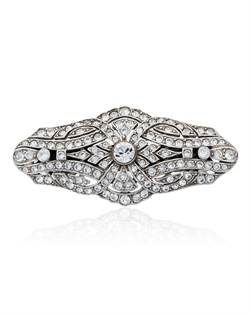 Bring a touch of vintage elegance to any formal ensemble with this lovely crystal barrette from designer Ben Amun. Round brilliant cut Swarovski crystals sparkle beautifully in a gorgeous antique-inspired setting. Chic and charming.